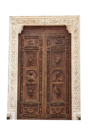 Main wooden door at Santa Croce church, Florence, isolated over white background. Stock Photo - 7852571