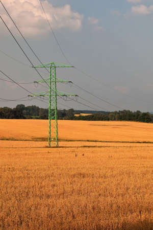 Rural, farmland landscape with high voltage electricity power line. photo