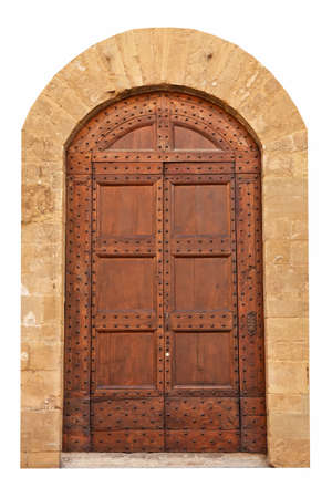 Wooden closed brown door with ornaments and two doorhandle, Italy. photo