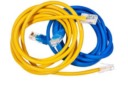 Blue and yellow patch cords with RJ45 plugs isolated over white background. photo