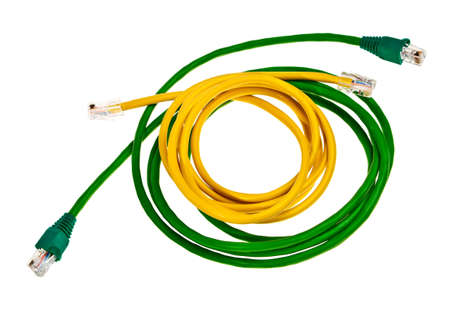 Green, yellow patch cords with RJ45 plugs isolated over white background. photo