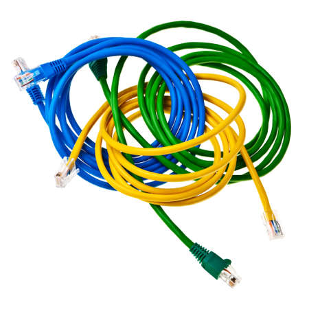 Yellow, green and blue patch cords with plugs isolated over white background. photo