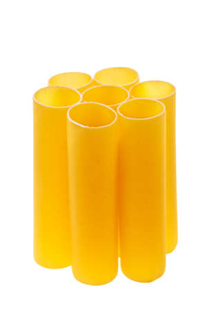 Italian cannelloni pasta tubes stacked over white background. photo