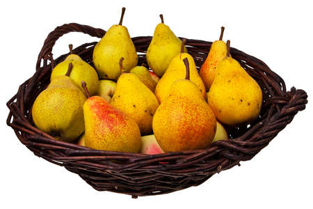 willow fruit basket: Wicker cane basket with pears and apples isolated over white background.