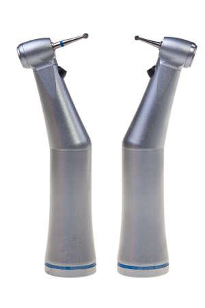 Dos herramientas de perforación dental aislados sobre fondo blanco.
