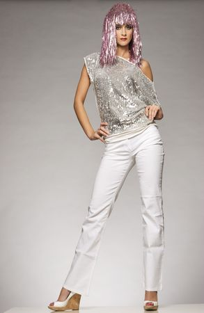 lucid: beautiful girl dressed for carnival wearing glossy pink wig and silver blouse on light background