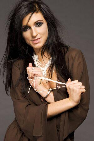 20 25: portrait of attractive brunette model on grey backgroubd