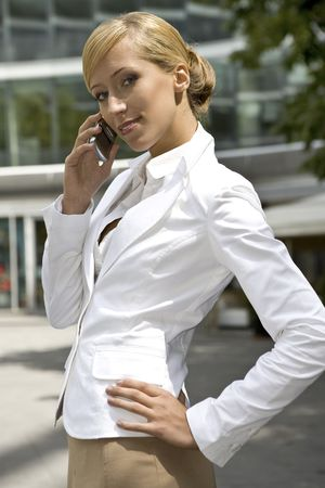 attractive and confident businesswoman talking on the phone Stock Photo - 3341486