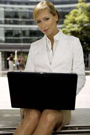 young and attractive businesswoman working on laptop outdoors Stock Photo - 3341484