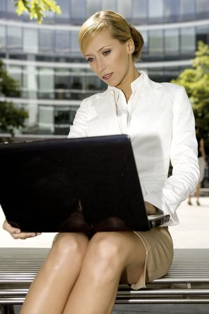 young and attractive businesswoman working on laptop outdoors Stock Photo - 3341487