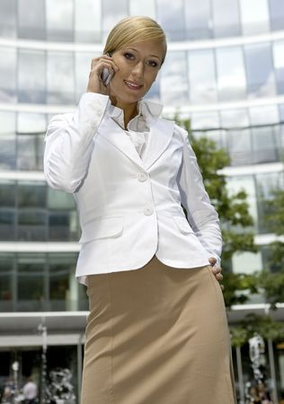 attractive and confident businesswoman talking on the phone Stock Photo - 3344218