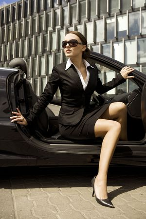 attractive brunette businesswoman in a cabrio car photo
