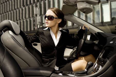 beautiful brunette businesswoman driving a cabrio car Stock Photo - 3775225