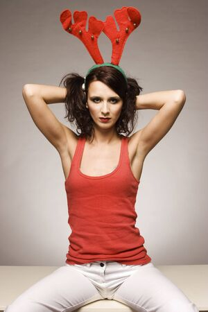 santa moose: beautiful brunette christmas reindeer girl with antlers