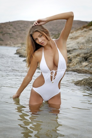 Young fashion brunette woman in swimwear on the beach Stock Photo - 8814583