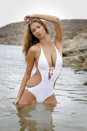 Young fashion brunette woman in swimwear on the beach Stock Photo - 8814559