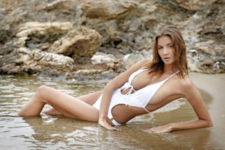 Young fashion brunette woman in swimwear on the beach Stock Photo - 8814642