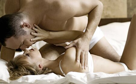 intimate young couple during foreplay in bed Stock Photo - 8814715