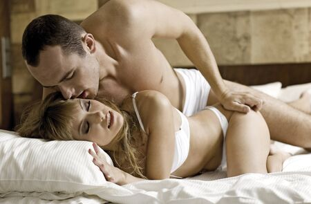 intimate young couple during foreplay in bed  Stock Photo - 8814730