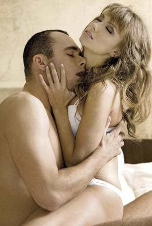 intimate young couple during foreplay in bed Stock Photo - 8814732