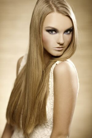 portrait of beautiful blonde girl with long hair photo