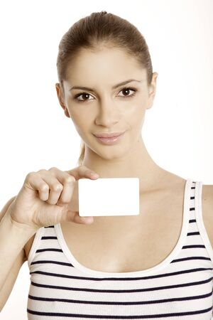 Beautiful smiling woman holding a membership card, bank or credit card, business card photo
