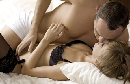 intimate young couple during foreplay in bed Stock Photo - 9696144