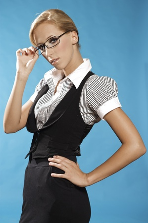 businness: beautiful blonde businness woman portrait, holding a glasses. Stock Photo