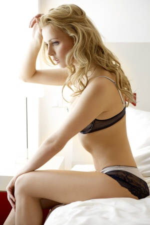 Young sexy blond woman in sexy lingerie Stock Photo