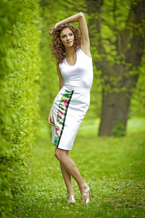 beautiful brunette in the garden photo