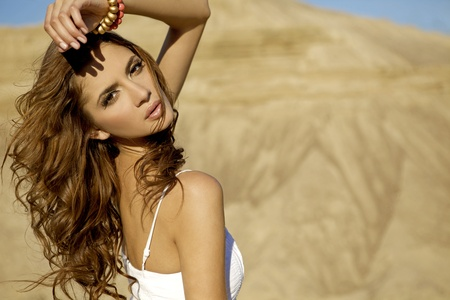 Fashionable young attractive and sensuality woman in the desert photo