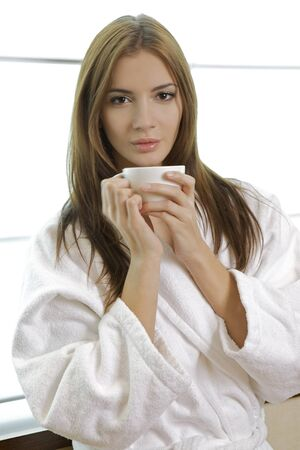 pjs: attractive young woman in PJs with her morning coffee