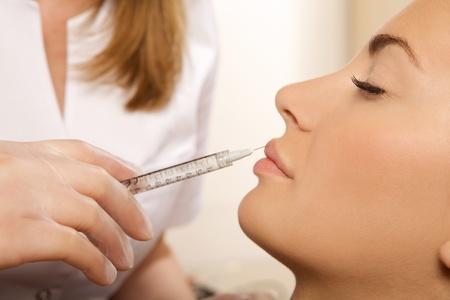 young beautiful woman having an injection photo