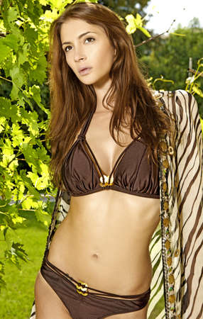 portrait of beautiful and sensuality brunette woman in outdoor photo