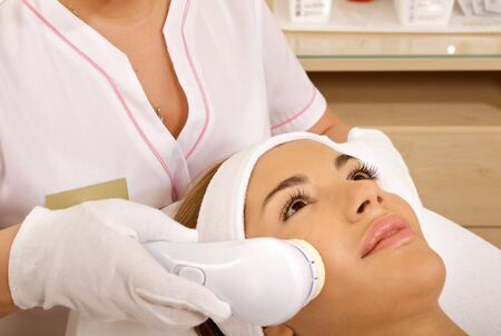 Laser hair removal in professional studio. photo