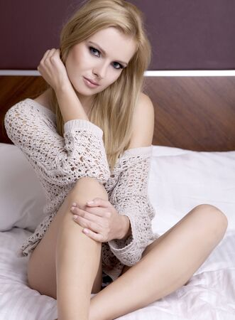 blond brown: Young sexy blond woman wear sweater in bed