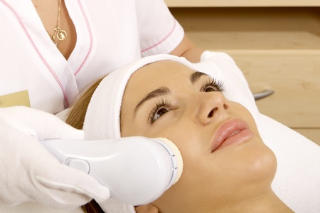 Laser hair removal in professional beauty studio. beauty parlor photo