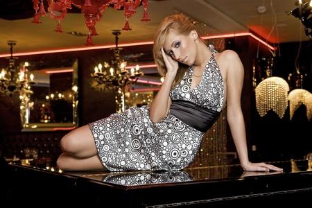 elegant blondie woman in black and white dress photo