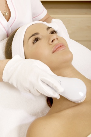 Laser hair removal in professional studio. Beautiful brunette woman. Stock Photo