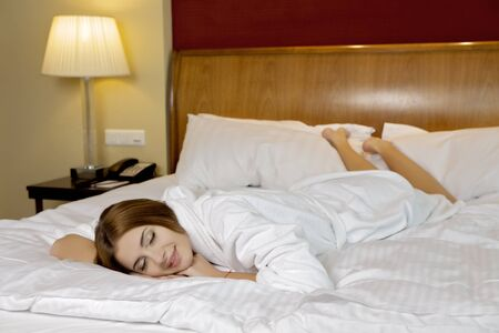 beautiful brunette woman in bed Stock Photo - 12361969