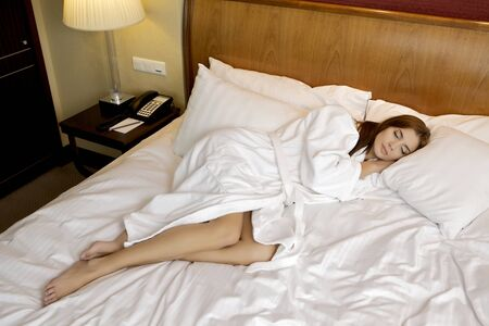 beautiful brunette woman in bed Stock Photo - 12361975