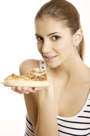 Young beautiful brunette woman eat pizza isolated on white background photo