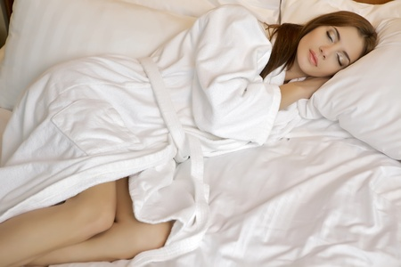 beautiful brunette woman in bed photo
