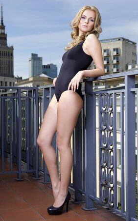 Beautiful slim sexy young blonde woman in balcony Stock Photo - 13477504