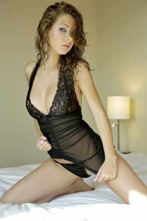 Beautiful and sexy woman wearing black lingerie in bed Stock Photo - 13780903