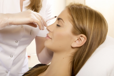 young beautiful woman having an injection mesotherapy Stock Photo