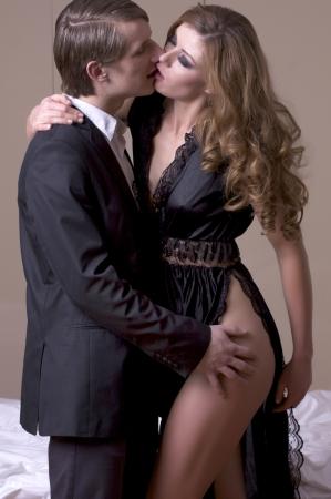 Portrait of elegant couple on grey background photo
