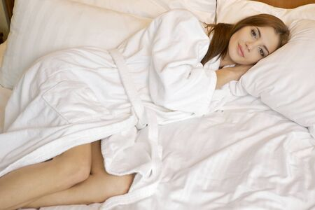 beautiful brunette woman in bed Stock Photo - 15448579