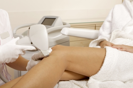 Young brunette woman receiving laser therapy  Spa studio shot