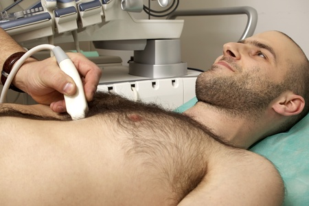 cardiac ultrasound examination testing on young men photo